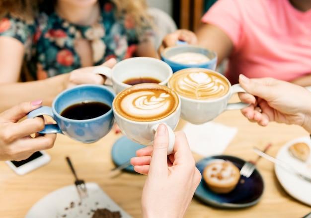 Friends having coffee together Premium Photo