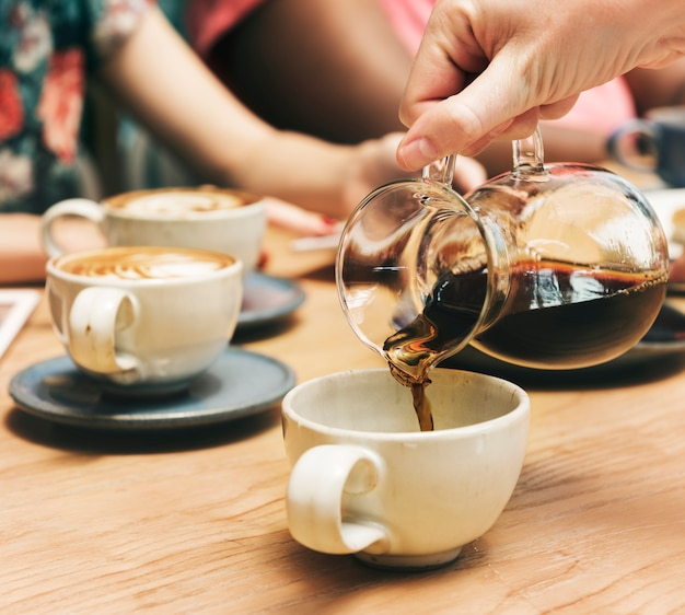 Friends having coffee together Free Photo