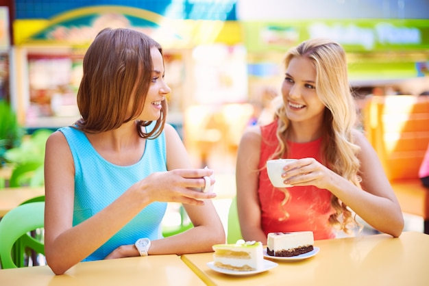Friends having a cup of tea and a piece of cake Free Photo