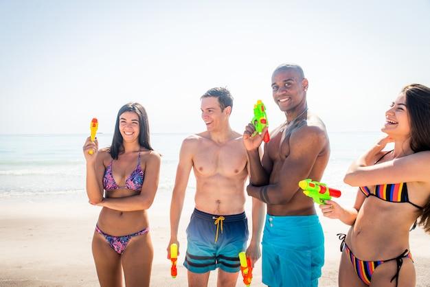 Friends having fun on the beach Premium Photo