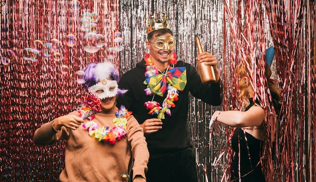 Friends having fun at carnival party Free Photo