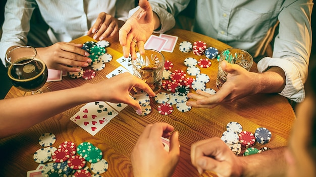 Friends having fun while playing board game. Free Photo