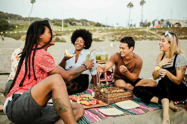 Friends having a picnic at the beach Premium Photo