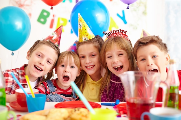 Friends laughing at a birthday party Free Photo