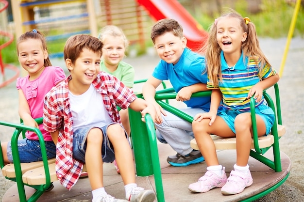 Friends laughing in the playground Free Photo