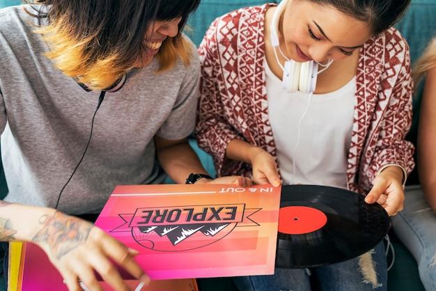 Friends listening music vintage record concept Premium Photo