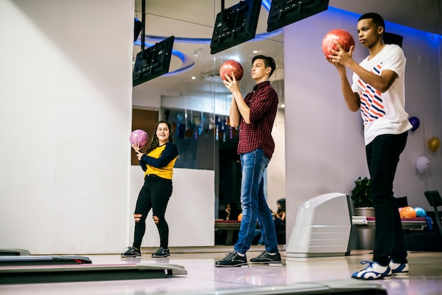 Friends playing bowling together Premium Photo