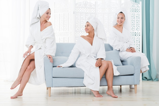 Friends posing with bathrobe in a spa Free Photo