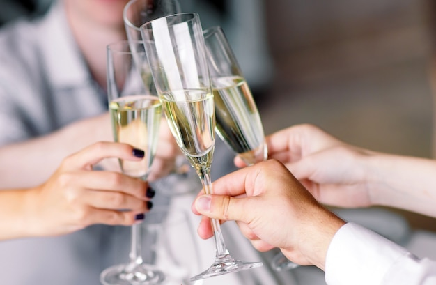 Friends in restaurant having a toast Premium Photo