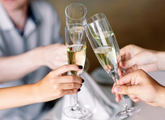Friends in restaurant having a toast Premium Photo