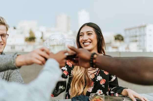 Friends toasting at a rooftop party Premium Photo