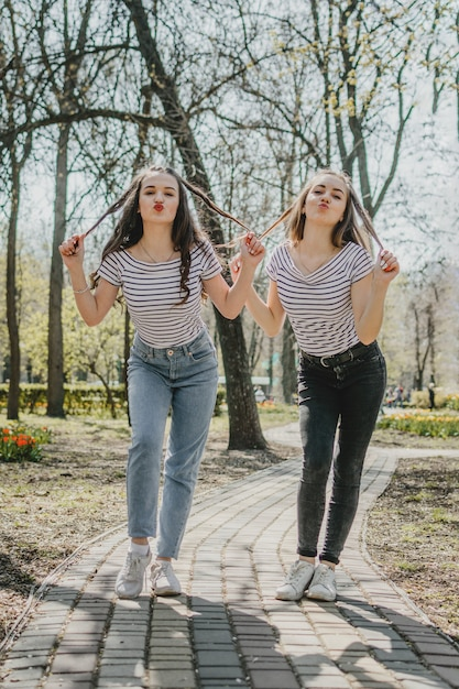 Friendship day two teenage girls having fun in the  park Premium Photo