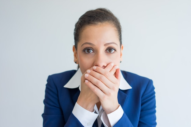 Frightened business woman keeping silence. Free Photo