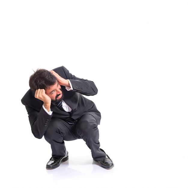 Frightened businessman over isolated white background Free Photo