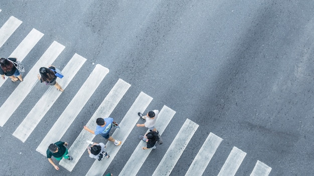 The from the top crosswise view of people walk on street pedestrian crossroad in the city street ,bird eye view. Premium Photo