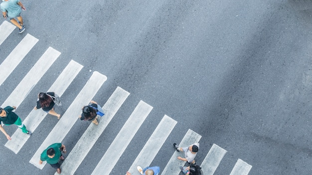 From the top view of people walk on street pedestrian crossroad in the city street Premium Photo