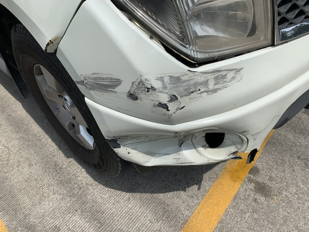 Front bumper damaged by a car accident. Premium Photo