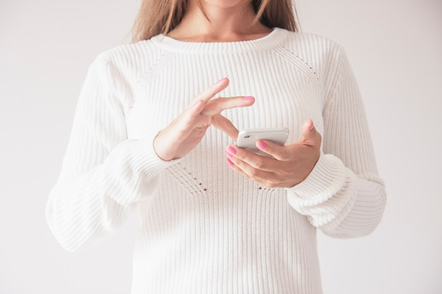 Front close up of woman using mobile smart phone, swiping up gesture Premium Photo