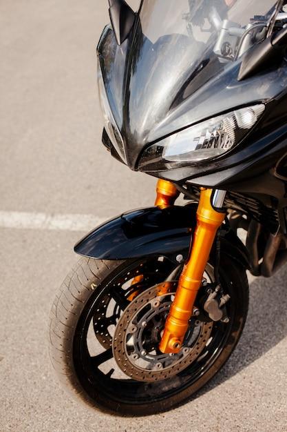 Front part of black motorbike Free Photo