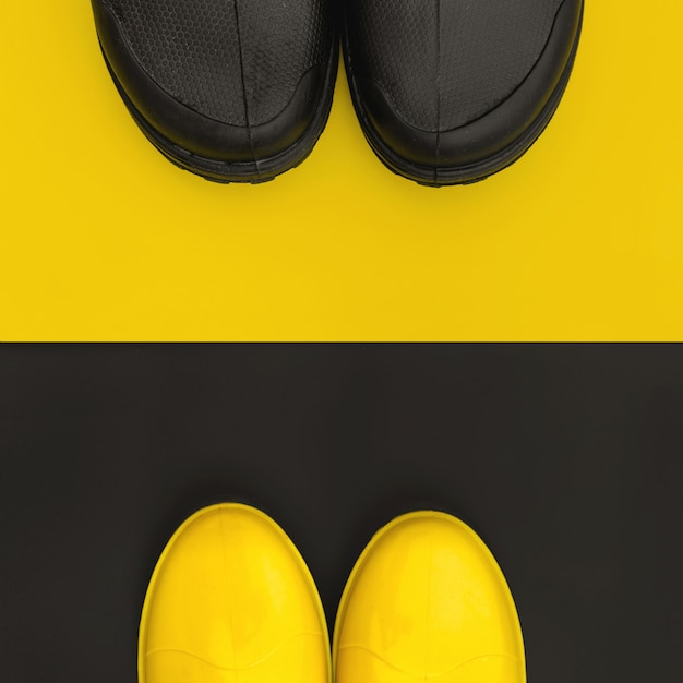 The front parts of the rain shoes are facing each other on the inversive backgrounds Premium Photo