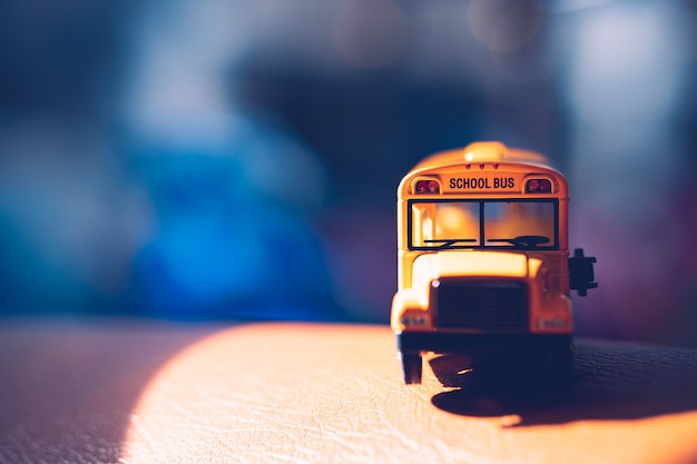 Front side of miniature yellow school bus with sunlight - vintage filter Premium Photo