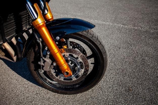 Front tire of orange motorbike Free Photo