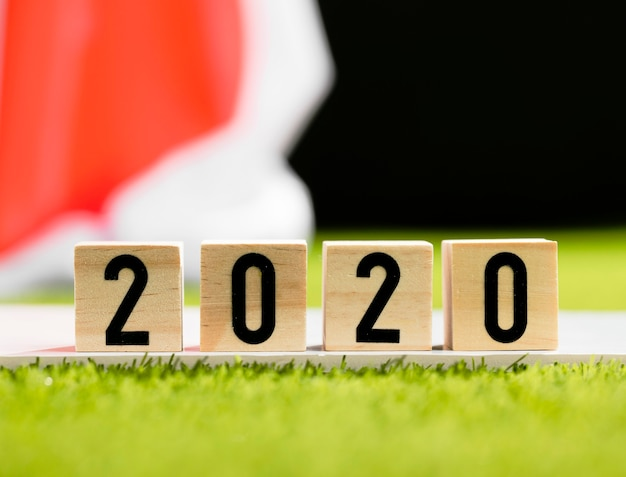 Front view 2020 on wooden cubes close-up Free Photo