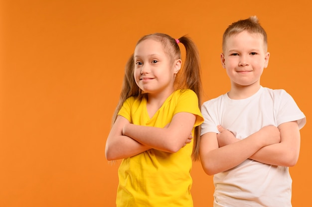 Front view adorable young boy and girl Free Photo