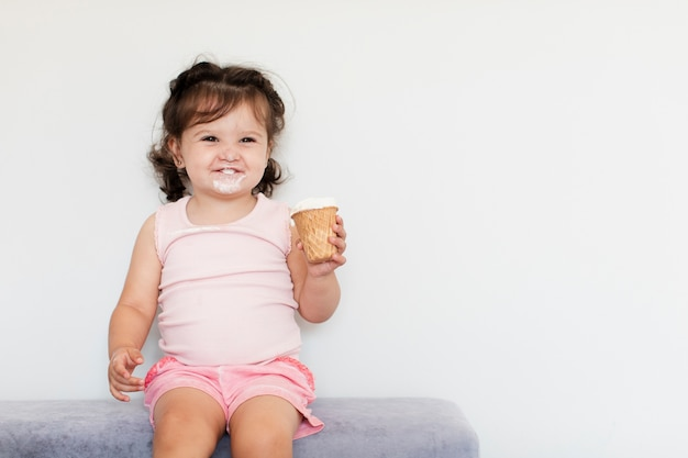 Front view adorable young girl with ice cream Free Photo