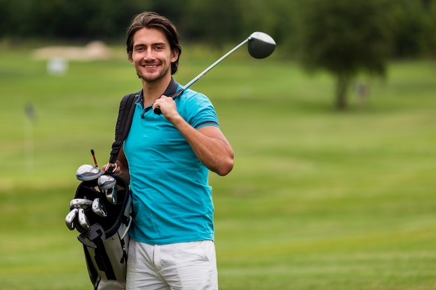 Front view adult man with golf clubs Free Photo