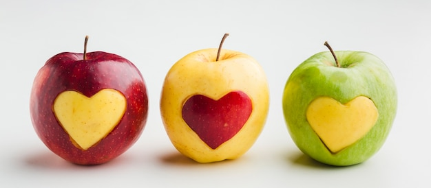 Front view of apples with fruit heart shapes Premium Photo