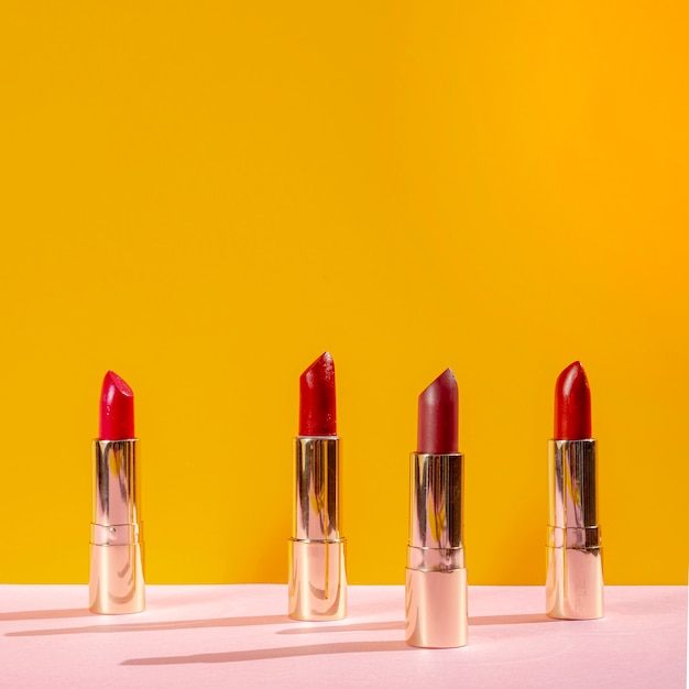 Front view arrangement of different lipsticks Free Photo