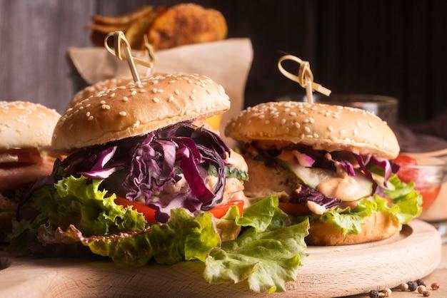 Front view arrangement of tasty hamburgers Free Photo