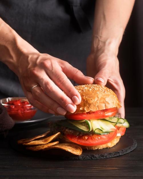 Front view arrangement with tasty hamburger Free Photo
