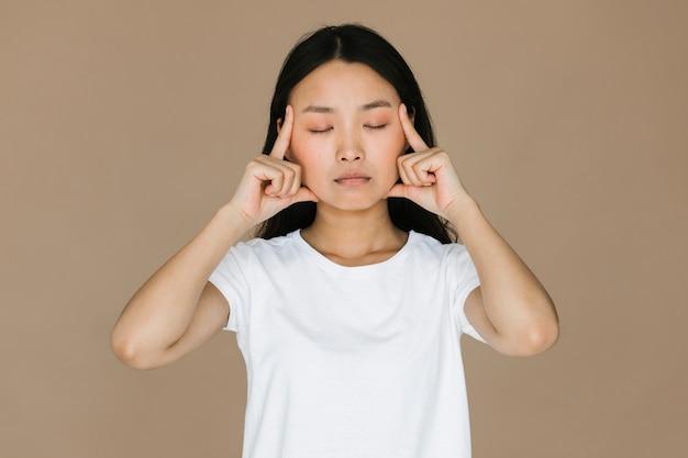 Front view asian woman meditating Free Photo