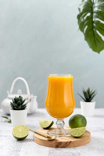 Front view assortment with fresh orange smoothie Free Photo