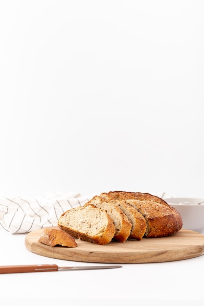 Front view baked bread on wooden board with copy space Free Photo