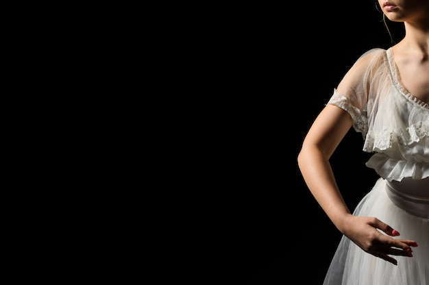 Front view of ballerina in dress and tutu with copy space Free Photo
