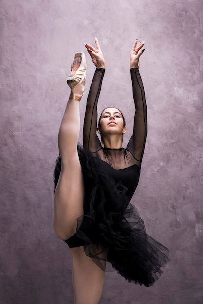 Front view ballerina with one leg up Free Photo
