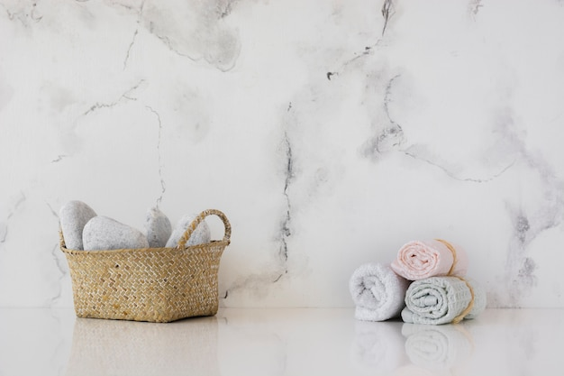 Front view basket and towels on table with marble backgrount and copy space Free Photo