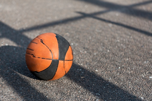 Front view basketball on asphalt Free Photo
