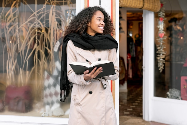 Front view beautiful woman holding a book Free Photo