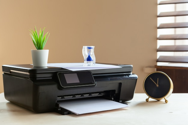 Front view of a black printer machine on a table Premium Photo