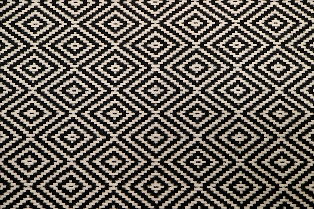 Front view of black and white ethnic pattern fabric for background or banner Premium Photo