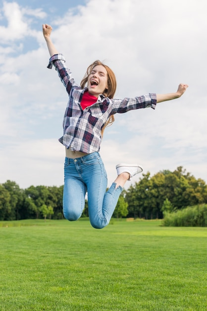 Front view blonde girl jumping Free Photo