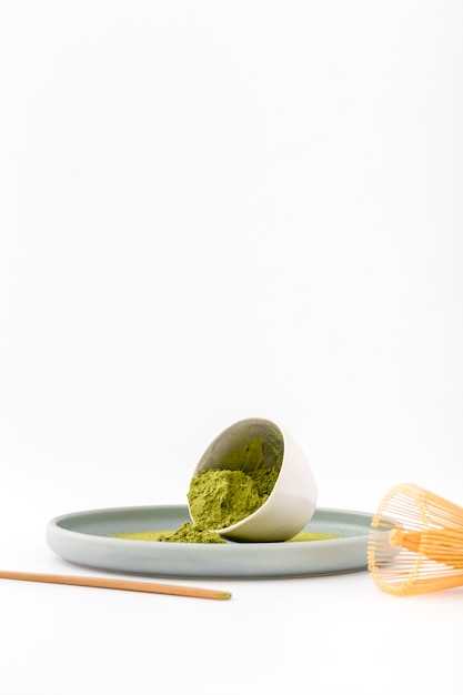 Front view bowl with aromatic matcha powder Free Photo