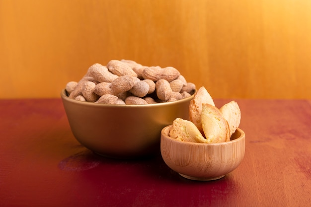 Front view of bowls of peanuts and fortune cookies for chinese new year Free Photo