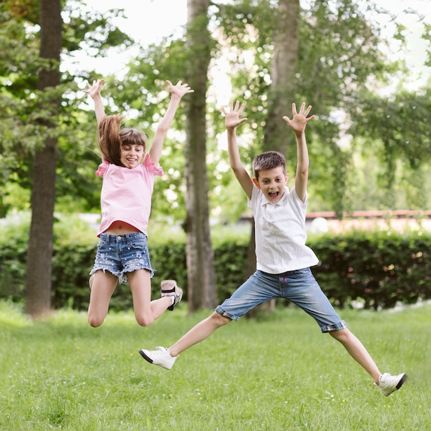 Front view boy and girl jumping Free Photo