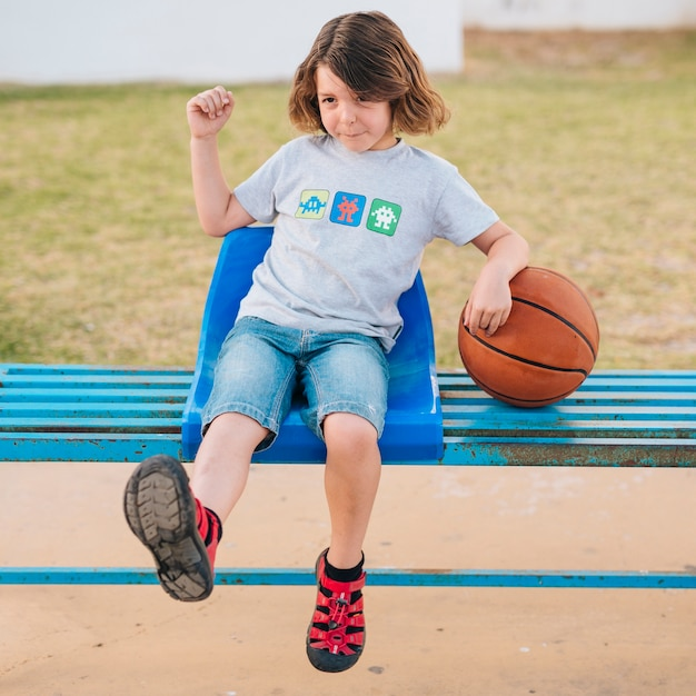 Front view of boy sitting in chair Free Photo