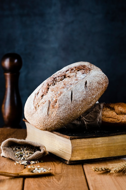 Front view of bread on a boon on wooden table Free Photo